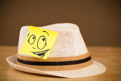 Post-it note with smiley face sticked on hat Royalty Free Stock Photos