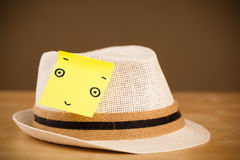 Post-it note with smiley face sticked on a hat Royalty Free Stock Images