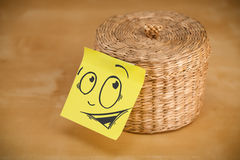 Post-it note with smiley face sticked on jewelry box Stock Image