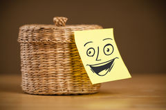 Post-it note with smiley face sticked on a jewelry box Stock Photos