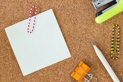 Post-it note and stationary on cork board Stock Photos