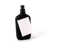 Post-it note sticked on a black bottle Royalty Free Stock Image
