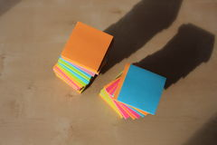 Post it note on the table. Mix color of post it note Royalty Free Stock Photography
