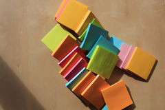 Mix color of Post it note. Post it note are on the table with wood texture background Stock Image