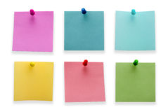 Post it notes. A different color post it notes with spins isolated on white background. Studio light royalty free stock photography
