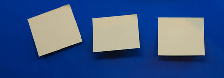 Post it notes. On a blue background Stock Photos