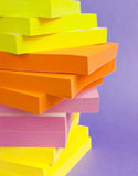 Post it notes colourful stack. Colourful stack of post-it-notes on purple background stock photo