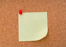 Post it notes on cork board . Royalty Free Stock Photography