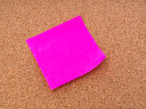 Post it notes on cork board . Royalty Free Stock Photo