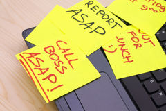 Post it notes on a laptop PC stock photos