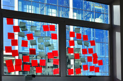 Post it notes on office building window Royalty Free Stock Photography