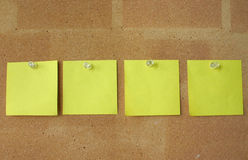 Post-it notes pinned in line Royalty Free Stock Photo