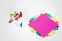 Post-it notes with small colored pegs stock photos