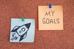 Post it Notes with Space Rocket and words My Goals on bulletin b royalty free stock photos