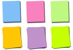 Post-it notes in varying positions and colors Stock Photo