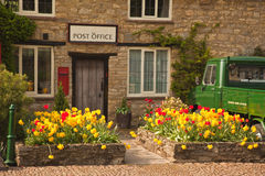 Post Office. Old English Post Office with truck parked in spring sunshine Royalty Free Stock Image