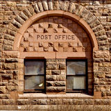 Post Office. Written atop on old style window stock images