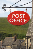 Post office. Sign outside post office of old English village Stock Images