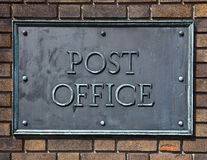Post Office. Sign made of brass and bolted on a brick wall Royalty Free Stock Photography