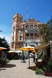 Post office building, Cadiz. Flower stalls and cafes in the Plaza de las Flores with the Post Office building to the rear, Cadiz, Cadiz Province, Andalusia Royalty Free Stock Images