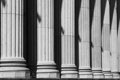 Post Office Columns. A row of stone columns provide a classical entrance to the New York City post office. In black and white Royalty Free Stock Images