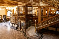 The Post Office Interior in Mexico City. The gold and marble elegant stair and elevator inside the historical Post Office in downtown Mexico City. The Palacio de stock image