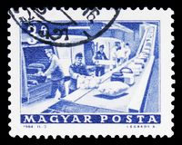 Post Office parcel conveyor, serie, circa 1964. MOSCOW, RUSSIA - FEBRUARY 10, 2019: A stamp printed in Hungary shows Post Office parcel conveyor, serie, circa stock photos