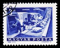 Post Office parcel conveyor, serie, circa 1964. MOSCOW, RUSSIA - FEBRUARY 10, 2019: A stamp printed in Hungary shows Post Office parcel conveyor, serie, circa royalty free stock images