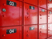 Post Office: red mailboxes detail. Bright red numbered mailboxes in New Zealand post office Stock Photos