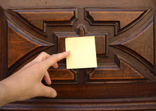 Post-it and old door Stock Image
