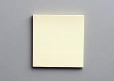 Post-it om grey Royalty Free Stock Image