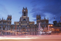 Post palace at nightfall of Madrid city, Spain stock images