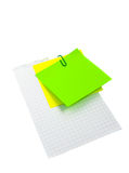 Post-it on the paper. Post-it on the sheet of paper with clip Royalty Free Stock Images