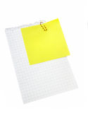 Post-it on the paper. Post-it on the sheet of paper with clip Royalty Free Stock Photo