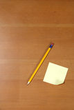 Post it and Pencil on desk Stock Photography