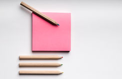 Post it with pencils. On a with background Stock Photography