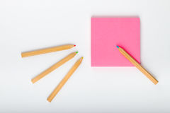 Post it with pencils. Post it on a with background Stock Images