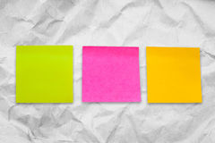 Post it,pink,yellow. On crumpled paper background Royalty Free Stock Photo