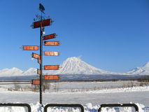 Post-pointer. With distances to various cities in the world stands at the entrance to the city of Elizovo, near the monument bears. Kamchatka stock photography