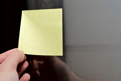 Post-it on refrigerator door Stock Images