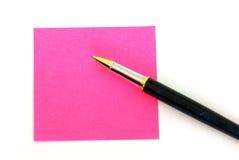 Post-it rosado Fotografía de archivo libre de regalías