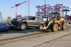 Post Sandy. Car damaged by water flooding from hurricane Sandy being towed Royalty Free Stock Photography