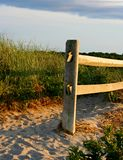 Post and Shadows on Cape Cod. Cape Cod MA, beach at sunset. Sand path away from shore Stock Photo