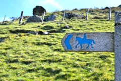 Post sign horse riders on the path 1 Royalty Free Stock Image