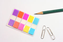 Post-it small index, pencil and clip. On table Royalty Free Stock Photos