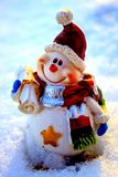 Post snowman. Snowman post brought to you by postcard greetings with best wishes Stock Photo