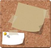 Post-it sobre um corkboard Imagens de Stock