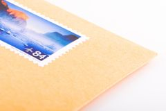 Post stamp. Shoot of letter with stamp on a white background Royalty Free Stock Images
