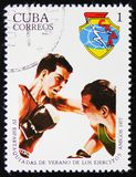 MOSCOW, RUSSIA - APRIL 2, 2017: A post stamp printed in Cuba shows two boxers, 4 Spartakiad, circa 1977 stock photography