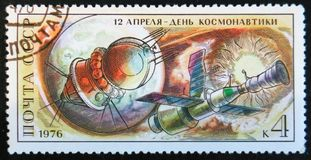 Post stamp printed in USSR devoted to astronautics day, circa 1976. MOSCOW, RUSSIA - APRIL 2, 2017: A post stamp printed in USSR shows April 12 - day of Royalty Free Stock Photo